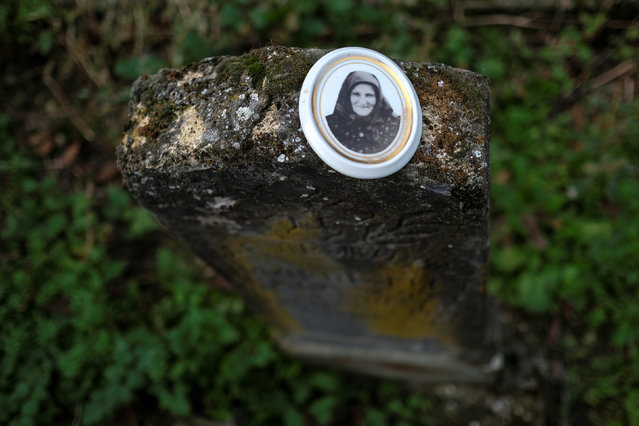 A picture of a deceased woman is seen on an old grave at a cemetery in the village of Sapine, Serbia, October 25, 2016. (Photo by Marko Djurica/Reuters)