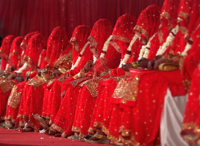 Muslim brides participate in a mass marriage event in Mumbai on February 14, 2021. (Photo by Indranil Mukherjee/AFP Photo)