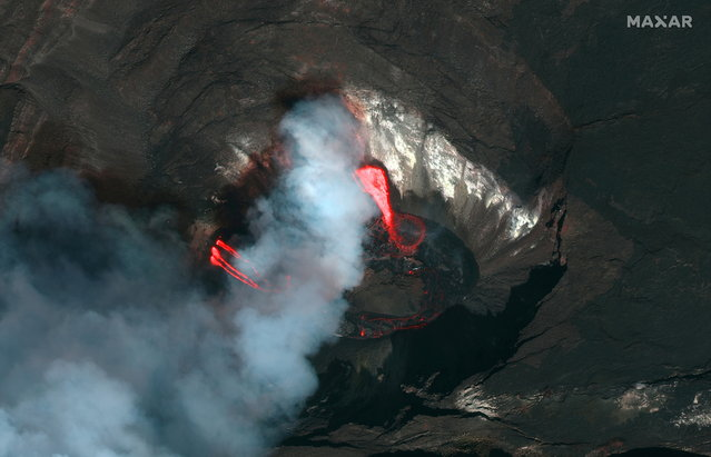 A Maxar's WorldView-2 satellite color infrared image shows a closeup view of the Kilauea volcano crater and lava erupting of  the Kilauea volcano in Hawaii, U.S., December 21, 2020. (Photo by Satellite image ©2020 Maxar Technologies/Handout via Reuters)