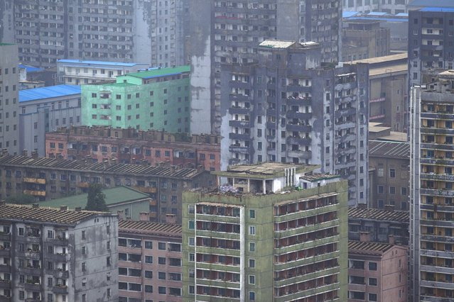 A North Korean building block stands along the Taedong River in central Pyongyang on Tuesday, July 23, 2013. (Photo by David Guttenfelder/AP Photo)