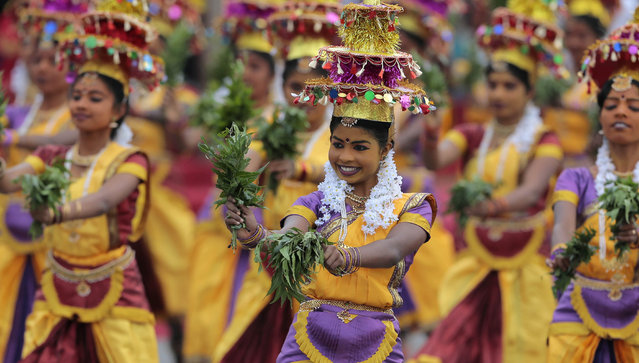 Sri Lankan ethnic Tamil dancers from northern province perform during Independence Day celebrations in Colombo, Sri Lanka, Wednesday, February 4, 2015. (Photo by Eranga Jayawardena/AP Photo)