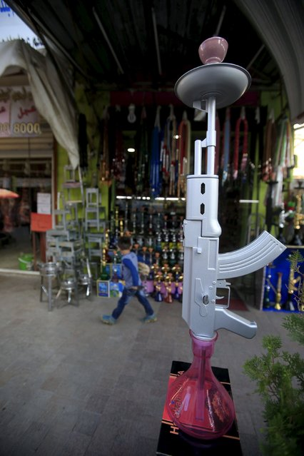 A hookah shaped like a rifle is displayed for sale in a souk at the port city of Sidon, southern Lebanon, December 23, 2015. (Photo by Ali Hashisho/Reuters)