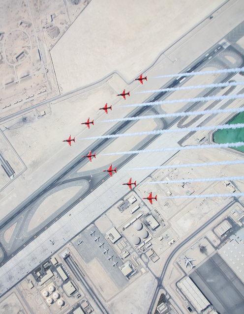 """Parallels"". Image of the Year, first prize: The Red Arrows arrive over Doha, Qatar, as part of their Eastern Hawk tour. (Photo bu SAC Hannah Smoker/RAF)"