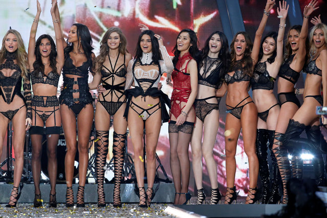 Models including Kendall Jenner, Izabel Goulart and Barbara Fialho celebrate at the end of the 2016 Victoria's Secret Fashion Show at the Grand Palais in Paris, France, November 30, 2016. (Photo by Charles Platiau/Reuters)