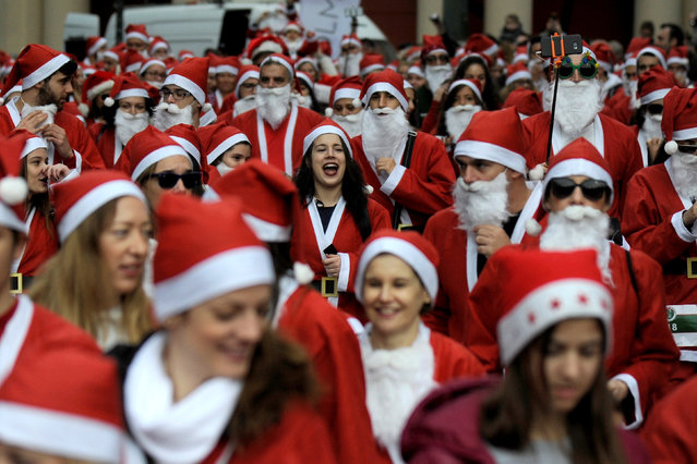 People dressed in Santa costumes take part in the Santa Run Athens, in Athens, Greece, December 4,  2016. (Photo by Michalis Karagiannis/Reuters)