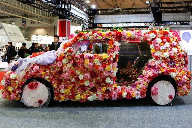 A custom car heavily decorated in flowers is shown on display at the 2016 Tokyo Auto Salon car show on January 15, 2016 in Chiba, Japan. TOKYO AUTO SALON 2016 is held from January 15 to 17, 2016. (Photo by Christopher Jue/Getty Images)