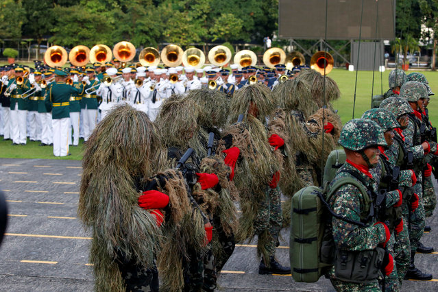 Soldiers parade for the change of command for the new Armed Forces chief at a military camp in Quezon City, Metro Manila, Philippines December 7, 2016. (Photo by Erik De Castro/Reuters)