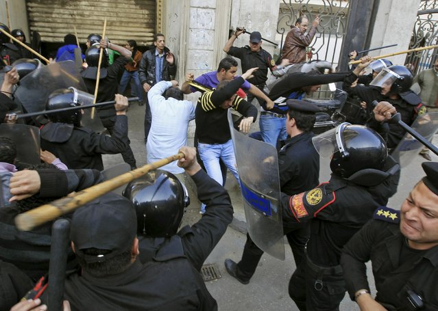 Riot police clash with protesters in Cairo January 26, 2011. (Photo by Goran Tomasevic/Reuters)