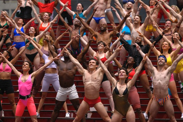 """Members and cast of the charitable fundraising show """"Broadway Bares"""" perform during a video shoot entitled """"Twerk from Home"""" in Times Square on May 24, 2021. Broadway Bares was created in 1992 by Tony Award-winning director and choreographer Jerry Mitchell as a way to raise awareness and money for those living with HIV/AIDS. (Photo by Ed Jones/AFP Photo)"""