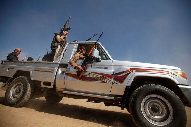 Tribesmen ride in a pick-up during a tribal gathering held to show support to the new government formed by Yemen's armed Houthi movement and its political allies, in Sanaa, Yemen December 6, 2016. (Photo by Khaled Abdullah/Reuters)