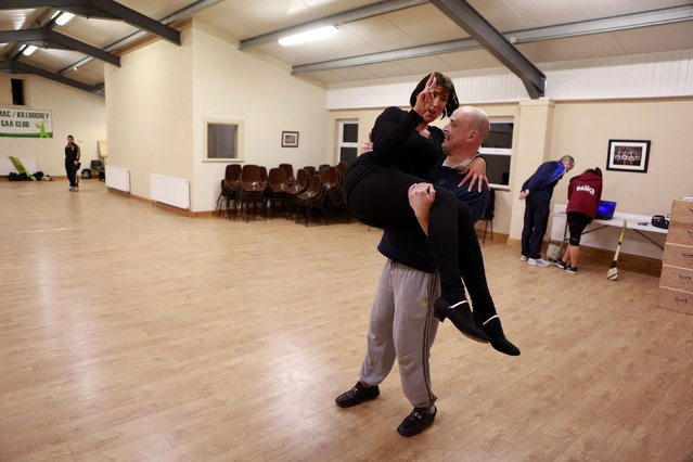 Fr Pierre Pepper lifts his dance partner during rehearsals for a charity event near the village of Banagher County Offaly February 12, 2015. (Photo by Cathal McNaughton/Reuters)