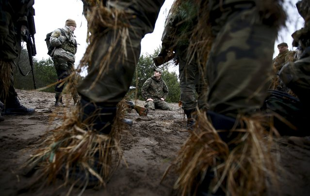 Beata Noskowicz (L) from Obrona Narodowa, a paramilitary organisation, takes part in a territorial defence training organised by paramilitary group SJS Strzelec (Shooters Association) in the forest near Minsk Mazowiecki, eastern Poland March 14, 2014. (Photo by Kacper Pempel/Reuters)