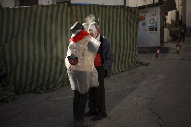 """A woman covers the face of a man with talcum powder during """"El Dia de los Polvos"""" (Powder Day) festival in Tolox, near Malaga, southern Spain, February 9, 2016. (Photo by Jon Nazca/Reuters)"""