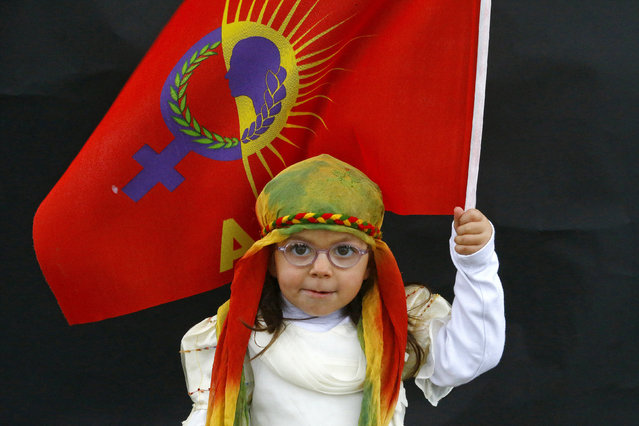 A Kurdish girl poses for a picture as she arrives for a gathering celebrating Newroz in Diyarbakir March 21, 2015. Kurds applauded last weekend's call from their jailed rebel leader Abdullah Ocalan to end a 30-year armed struggle against Turkey but deep suspicions on both sides could shatter dreams of peace. (Photo by Umit Bektas/Reuters)