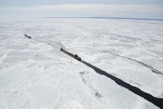 Freighters trapped in ice are shown in this aerial photo near Whitefish Bay on Lake Superior northwest of Sault Ste. Marie, Ontario April 7, 2015. (Photo by Kenneth Armstrong/Reuters)