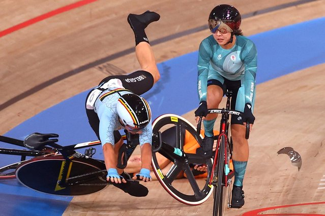 Riders from Netherland and Belgium crashes in the women's track cycling madison final during the Tokyo 2020 Olympic Games at Izu Velodrome in Izu, Japan, on August 6, 2021. (Photo by Matthew Childs/Reuters)