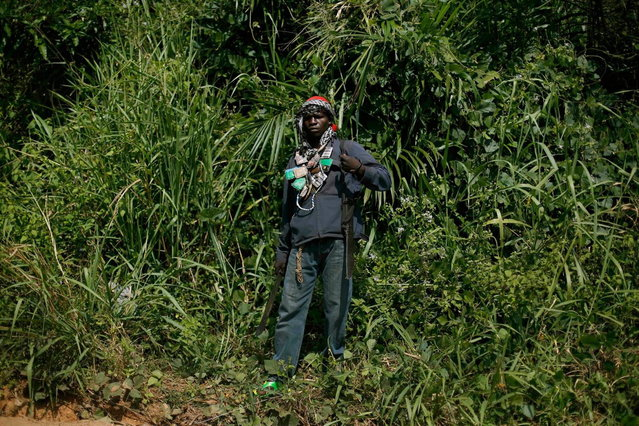 An anti-Balaka Christian militiaman stands in a forest clearing outside Central African Republic's capital Bangui, Sunday December 15, 2013. (Photo by Jerome Delay/AP Photo)