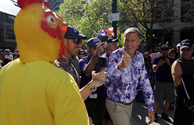 People's Party of Canada (PPC) leader Maxime Bernier gives a thumbs up to man in a rubber chicken outfit during a protest rally outside the Canadian Broadcasting Corporation (CBC) headquarters ahead of a federal election in Toronto, Ontario, Canada on September 16, 2021. (Photo by Chris Helgren/Reuters)