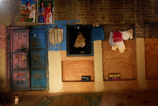 Posters are seen inside a house of a snake charmer in Jogi Dera (snake charmers settlement), in the village of Baghpur, in the central state of Uttar Pradesh, India November 10, 2016. (Photo by Adnan Abidi/Reuters)