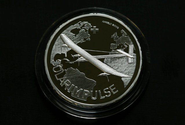 The front of the 20 Swiss Francs Solar Impulse official commemorative coin is displayed at Swissmint in Bern April 16, 2015. Swissmint are honouring Swiss pilots Bertrand Piccard and Andre Borschberg, who are attempting their first round-the-world solar-powered flight with their Solar Impulse 2 experimental aircraft, with a commemorative coin. (Photo by Ruben Sprich/Reuters)