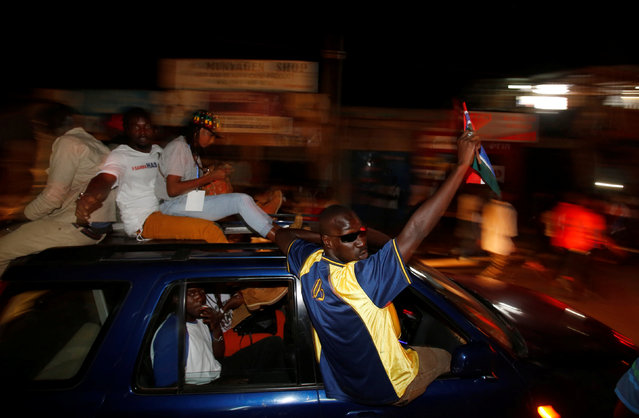 People celebrate the arrival  of Gambia's new President Adama Barrow to the country, at the airport in Serekunda, Gambia January 26, 2017. (Photo by Thierry Gouegnon/Reuters)