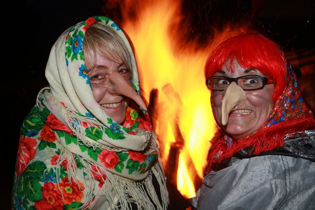 "In this April 30, 2015 photo women dressed up as witches and devils celebrate Walpurgis night in Schierke, Germany. The festival in the Harz Mountains was made famous by Goethes ""Faust"". His descriptions of witches riding brooms or goats up to the peak of Brocken mountain to celebrate an orgy with the devil still attract thousands of visitors to the Walpurgis night celebrations in the Harz region. (Photo by Matthias Bein/AP Photo/DPA)"