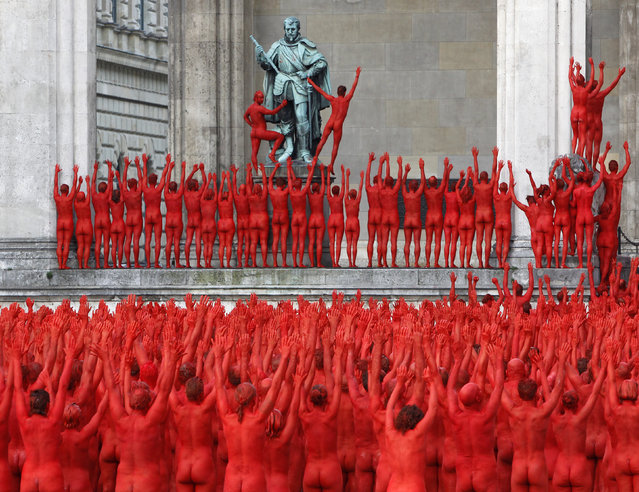 Naked volunteers, numbering around 1700 people, pose for U.S. artist Spencer Tunick in downtown Munich June 23, 2012. (Photo by Michaela Rehle/Reuters)