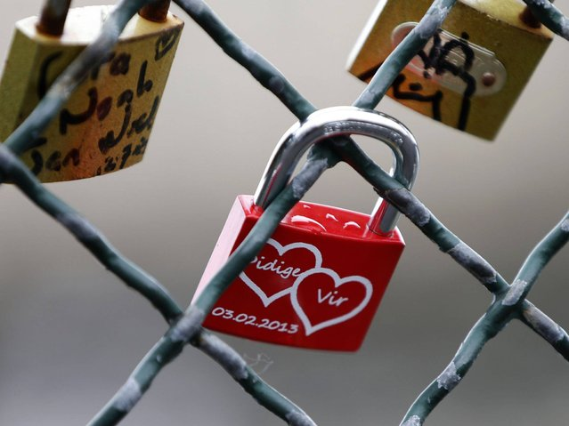 Since the 2000s, love locks have proliferated at an increasing number of locations worldwide. (Photo by Charles Platiau/Reuters)