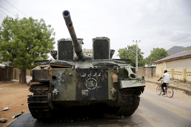 An armoured tank is seen abandoned along a road in Bazza town, after the Nigerian military recaptured it from Boko Haram, in Adamawa state May 10, 2015. (Photo by Akintunde Akinleye/Reuters)