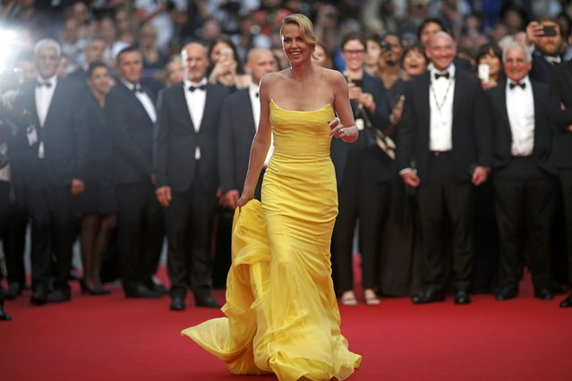 "Cast member Charlize Theron poses on the red carpet as she arrives for the screening of the film ""Mad Max: Fury Road"" out of competition at the 68th Cannes Film Festival in Cannes, southern France, May 14, 2015. (Photo by Benoit Tessier/Reuters)"