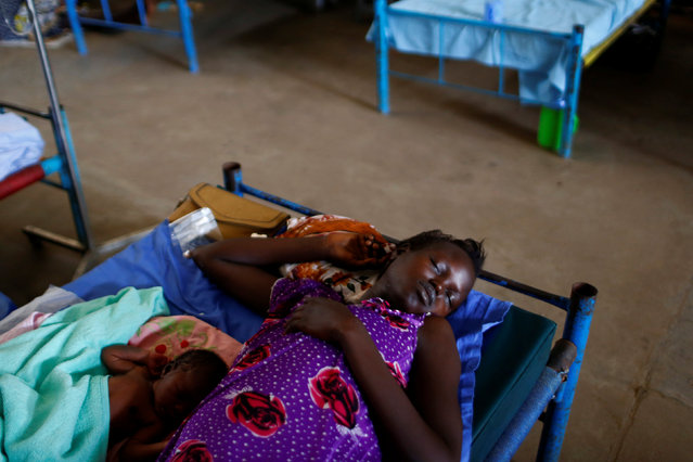 A mother with her child sleep in a bed of the paediatric ward of an hospital in the United Nations Mission in South Sudan (UNMISS) Protection of Civilian site (PoC), outside the capital Juba, South Sudan, January 24, 2017. (Photo by Siegfried Modola/Reuters)