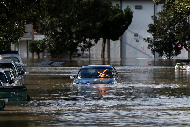 A vehicle is seen partially submerged in flood water after heavy rains overflowed nearby Coyote Creek in San Jose, California, U.S., February 21, 2017. (Photo by Stephen Lam/Reuters)