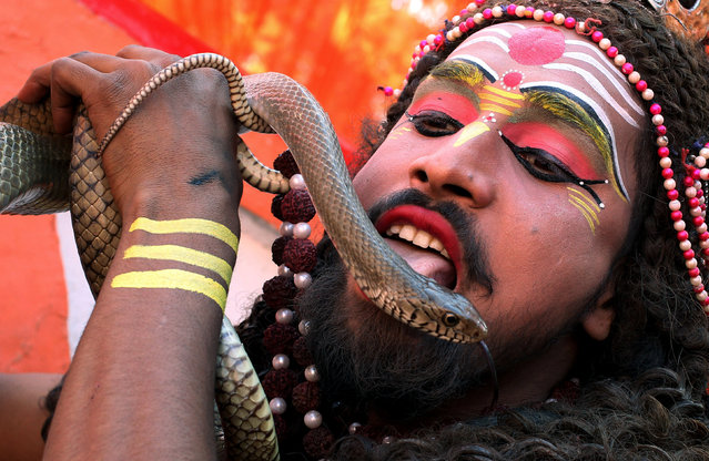 A man dressed as Hindu Lord Shiva performs during a religious procession ahead of the Hindu festival of Maha Shivaratri, in Jammu February 23, 2017. (Photo by Mukesh Gupta/Reuters)