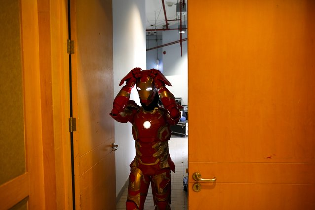 A fan dressed as the Iron Man character prepares backstage before a news conference at Bangkok Entertainment Week 2016 at Bangkok Art and Culture Centre (BACC), Thailand, April 21, 2016. (Photo by Athit Perawongmetha/Reuters)