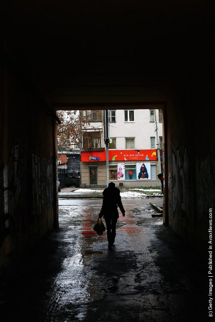 A woman is seen walking down an alleyway in Yekaterinburg, Russia