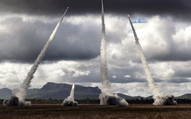 A handout photo made available by the Australian Department of Defence on 10 July 2019 shows United States Army and United States Marine Corps perform a live fire of M142 High Mobility Artillery Rocket Systems at Shoalwater Bay Training Area in Queensland, Australia. Talisman Sabre 2019 (TS19) is a bilateral training activity between Australian and United States military personnel. Approximately 25,000 people are expected to be involved in the exercises over the next month. (Photo by Sgt David Hicks/EPA/EFE/Rex Features/Shutterstock)