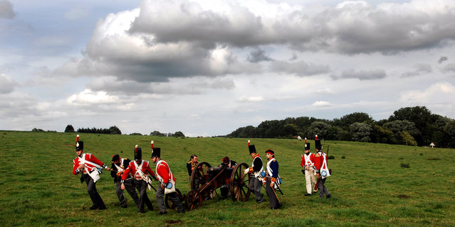 In this June 16, 2007, file photo, actors dressed as soldiers pull a cannon during a re-enactment of the Battle of Waterloo in Braine-l'Alleud, near Waterloo, Belgium. The Battle of Waterloo, fought on June 18, 1815, was Napoleon Bonaparte's last battle, as his defeat put a final end to his rule as Emperor of France. (AP Photo/Geert Vanden Wijngaert, File)