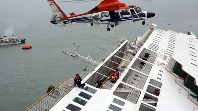 In this image taken from video released by News Y via Yonhap, passengers from a ferry sinking off South Korea's southern coast, are rescued by a South Korean Coast Guard helicopter in the water off the southern coast near Jindo, south of Seoul, Wednesday, April 16, 2014. (Photo by AP Photo/Yonhap)
