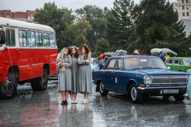 "Actresses take part in a street performance in central Moscow, Russia, on August 7, 2019. ""Probka Mira"", a street performance depicting a traffic jam, took place in Muzeon park of central Moscow on Wednesday. Around 200 actors took part in the performance. (Photo by Maxim Chernavsky/Xinhua News Agency/Barcroft Media)"
