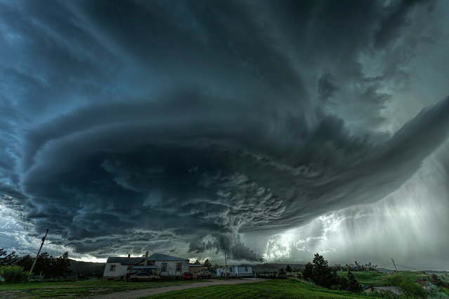 A supercell thunderstorm rises over the town of Blackhawk, South Dakota. (Photo by James Smart/2016 National Geographic Travel Photographer of the Year Contest)