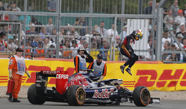 Toro Rosso driver Carlos Sainz of Spain jumps out off his car during the British Formula One Grand Prix at Silverstone circuit, Silverstone, England, Sunday, July 5, 2015. (Photo by Frank Augstein/AP Photo)