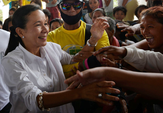 Presidential candidate Grace Poe shakes hands with supporters during an election campaign in Pandi, Bulacan in northern Philippines May 6, 2016. (Photo by Ezra Acayan/Reuters)