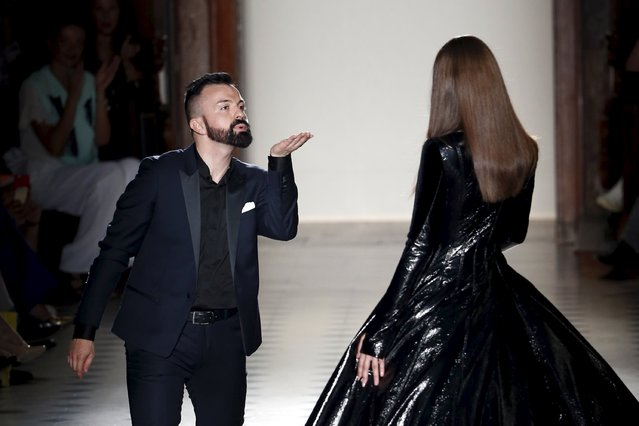 French designer Julien Fournie (L) blows a kiss to a model at the end of his Haute Couture Fall Winter 2015/2016 fashion show in Paris, France, July 7, 2015. (Photo by Charles Platiau/Reuters)