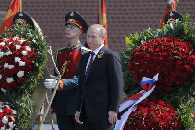 Russian President Vladimir Putin attends a wreath-laying ceremony to mark the 71st anniversary of the victory over Nazi Germany in World War Two, at the Tomb of the Unknown Soldier by the Kremlin walls in Moscow, Russia, May 9, 2016. (Photo by Maxim Shemetov/Reuters)