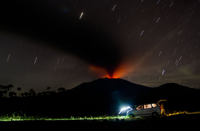 Mount Raung spews volcanic ash as seen from Sumber Arum village in Banyuwangi, East Java, Indonesia, 13 July 2015. A volcanic eruption on Indonesia's Java island has forced the closure of four airports, including those on the popular tourist islands of Bali. Mount Raung, located in East Java province, has been spewing ash and rocks since June, prompting authorities to raise its alert to the second highest level. (Photo by Fully Handoko/EPA)