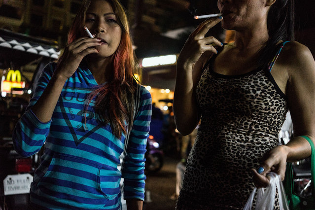 Jojo and Rose smoke cigarettes after a night at work. (Photo by Hannah Reyes Morales/The Washington Post)