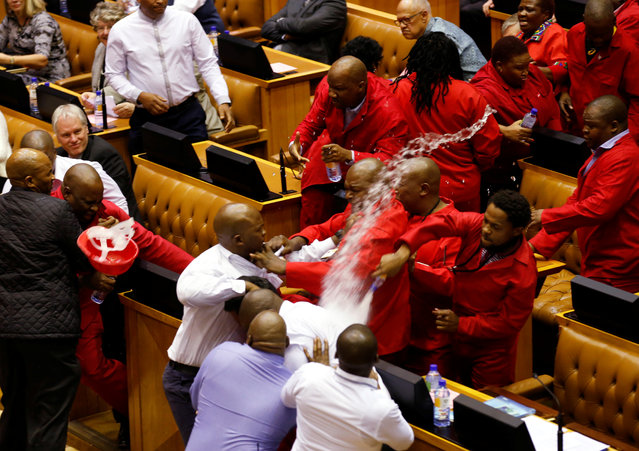 Party leader Julius Malema and members of his Economic Freedom Fighters (EFF) clash with parliamentary security as they are evicted from the chamber in Cape Town, South Africa, May 17, 2016. (Photo by Mike Hutchings/Reuters)