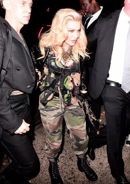 Madonna Wears Camo Army Gear to Met Gala After Party at 1oak as she arrived with Jeremy Scott on May 1, 2017. She got her makeup touched up in the car before walking out. (Photo by 247PAPS.TV/Splash News and Pictures)