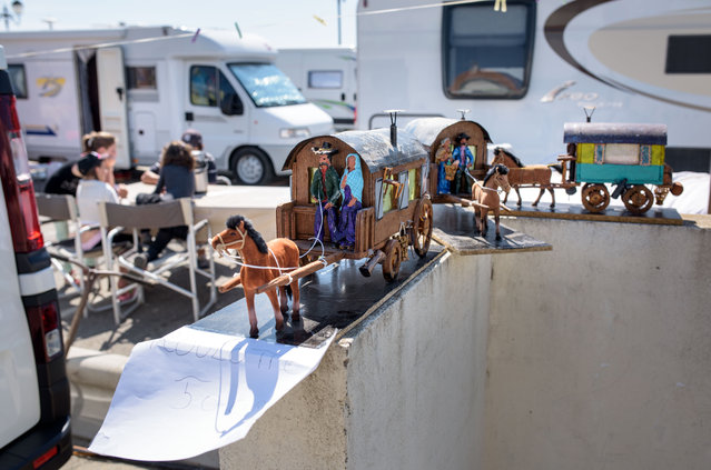 Models of traditional gypsy caravans are for sale stand in front of motorhomes on May 24, 2016 in Staintes Maries de la Mere near Arles, France. (Photo by Thomas Lohnes/Getty Images)