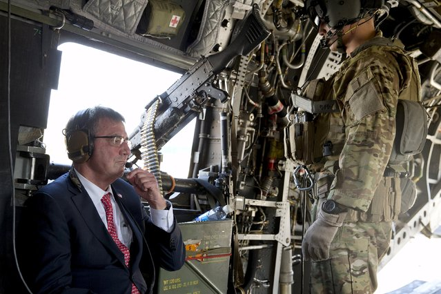 U.S. Defense Secretary Ash Carter rides on a Chinook helicopter during his visit to Baghdad, Iraq, July 23, 2015. U.S. Defense Secretary Carter made a surprise visit to Baghdad on Thursday to assess the campaign against Islamic State, as Iraq advances plans to retake the fallen capital of Sunni-dominated Anbar province. (Photo by Carolyn Kaster/Reuters)